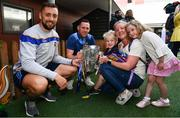 19 August 2019; James Barry, left, and Seán O'Brien of Tipperary, second from left, with Ed Mortimer, aged 2, Claire Joyce, Emily Mortimer, aged 5, from Lucan, Co. Dublin,  and the Liam MacCarthy Cup on a visit by the Tipperary All-Ireland hurling champions to Children's Health Ireland at Crumlin in Dublin.  Photo by Sam Barnes/Sportsfile