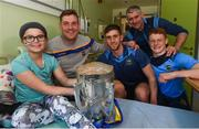 19 August 2019; Carla O'Connor aged 10, from Carrick on Suir, Co Tipperary, with, Tipperary players, from left, Séamus Callanan, Barry Heffernan, Jerome Cahill, Tipperary manager Liam Sheedy, and the Liam MacCarthy cup on a visit by the Tipperary All-Ireland hurling champions to Children's Health Ireland at Crumlin in Dublin.  Photo by Sam Barnes/Sportsfile