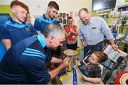 19 August 2019; Charlie Aabo, and his son Kian Barnes-Aabo, aged 5, from Glanmire, Co. Cork, are shown the Liam MacCarthy cup by Tipperary manager Liam Sheedy and Tipperary players on a visit by the Tipperary All-Ireland hurling champions to Children's Health Ireland at Crumlin in Dublin.  Photo by Sam Barnes/Sportsfile