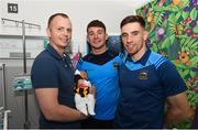 19 August 2019; Shay Treacy, aged 5 days, with his father James Treacy, from Callan, Co. Kilkenny, and Tipperary players Niall O'Meara, centre, and  Joe O'Dwyer on a visit by the Tipperary All-Ireland hurling champions to Children's Health Ireland at Crumlin in Dublin.  Photo by Sam Barnes/Sportsfile
