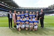 18 August 2019; INTO President Feargal Brougham, President of the Camogie Association Kathleen Woods, President of Cumann na mBunscol Mairead O'Callaghan, Uachtarán Chumann Lúthchleas Gael John Horan, with the Tipperary team, back row, left to right, Lauren Devaney, Diffreen NS, Manorhamilton, Leitrim, Megan O'Grady, Knockavilla NS, Knockavilla, Tipperary, Shauna MacSweeney, St. Patrick's NS , Bunclody, Wexford, Síofra Ní hOisín, Gael Scoil de hÍde, Cnoc na Crúibe, Ros Comáin, Lucy Donnelly, Scoil Mhuire, Tallow, Waterford, front row, left to right, Grainne Smith, St Patrick's NS, Geevagh, Sligo, Niamh Hasson, St Mary's PS, Dungiven, Derry, Amber McIntyre, Coronea NS, Cornafean, Cavan, Caoimhe McKee, Scoil na Caílín, Castleblayney, Monaghan, Catherine Moohan, St. Patrick's PS, Dungannon, Tyrone, ahead of the INTO Cumann na mBunscol GAA Respect Exhibition Go Games prior to the GAA Hurling All-Ireland Senior Championship Final match between Kilkenny and Tipperary at Croke Park in Dublin. Photo by Daire Brennan/Sportsfile