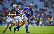 18 August 2019; Shauna MacSweeney, St. Patrick's NS , Bunclody, Wexford, representing Tipperary, in action against Anna O'Neill, Corpus Christi GNS, Drumcondra, Dublin, representing Kilkenny, during the INTO Cumann na mBunscol GAA Respect Exhibition Go Games prior to the GAA Hurling All-Ireland Senior Championship Final match between Kilkenny and Tipperary at Croke Park in Dublin. Photo by Ray McManus/Sportsfile