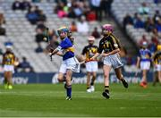 18 August 2019; Catherine Moohan, St. Patrick's PS, Dungannon, Tyrone, representing Tipperary, in action against Amelia Higgins, St. Brigid's NS, Castleknock, Dublin, representing Kilkenny, during the INTO Cumann na mBunscol GAA Respect Exhibition Go Games prior to the GAA Hurling All-Ireland Senior Championship Final match between Kilkenny and Tipperary at Croke Park in Dublin. Photo by Ray McManus/Sportsfile