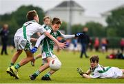 18 August 2019; Eoin Harris of Ballincollig, Co. Cork, is tackled by Nicky Faherty of Moycullen, Co. Galway, as he shoots to score his side's first goal while competing in the U10 Boys/Girls/Mixed Gaelic Football during Day 2 of the Aldi Community Games August Festival, which saw over 3,000 children take part in a fun-filled weekend at UL Sports Arena in University of Limerick, Limerick. Photo by Ben McShane/Sportsfile