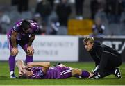 19 August 2019; Daniel Cleary of Dundalk is treated for an injury by team-mate Patrick Hoban, left, and Dundalk physiotherapist Danny Miller during the EA Sports Cup Semi-Final match between Dundalk and Bohemians at Oriel Park in Dundalk, Co. Louth. Photo by Ben McShane/Sportsfile