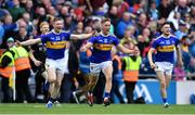 18 August 2019; Tipperary players, from left, Donagh Maher, Dan McCormack, and Alan Flynn celebrate after the GAA Hurling All-Ireland Senior Championship Final match between Kilkenny and Tipperary at Croke Park in Dublin. Photo by Piaras Ó Mídheach/Sportsfile