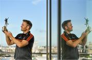 23 August 2019; PwC GAA/GPA Player of the Month for August Tipperary hurler Noel McGrath was at PwC offices in Dublin today to pick up his respective award. The player was joined by PwC's Managing Partner, Feargal O'Rourke, Ard Stiúrthóir Lúthchleas Gael, Tom Ryan, and GPA National Executive Council Member, Philip Greene. Pictured is Noel McGrath of Tipperary with his award at PwC, Spencer Dock, North Wall Quay, Dublin. Photo by Seb Daly/Sportsfile