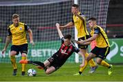 23 August 2019; Andy Lyons of Bohemians in action against Longford Town players, from left, Conor Kenna, Michael McDonnell, and Anto Breslin during the Extra.ie FAI Cup Second Round match between Bohemians and Longford Town at Dalymount Park in Dublin. Photo by Piaras Ó Mídheach/Sportsfile