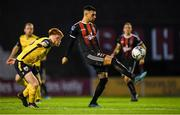 23 August 2019; Daniel Mandroiu of Bohemians in action against Aodh Dervin of Longford Town during the Extra.ie FAI Cup Second Round match between Bohemians and Longford Town at Dalymount Park in Dublin. Photo by Piaras Ó Mídheach/Sportsfile