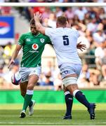 24 August 2019; Ross Byrne of Ireland kicks the ball as George Kruis of England defends during the Quilter International match between England and Ireland at Twickenham Stadium in London, England. Photo by Brendan Moran/Sportsfile