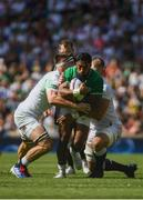 24 August 2019; Bunee Aki of Ireland is tackled by, left, George Kruis and, right, Tom Curry, of England, during the Quilter International match between England and Ireland at Twickenham Stadium in London, England. Photo by Ramsey Cardy/Sportsfile