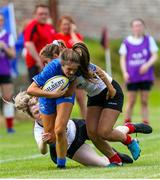 24 August 2019; Rachel Conroy of Leinster is tackled by Sarah Shrestha and Toni Macartney of Ulster during the Under 18 Girls Interprovincial Rugby Championship match between Ulster and Leinster at Armagh RFC in Armagh. Photo by John Dickson/Sportsfile