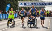 24 August 2019; Team James, left, and Daniel's Voyage, right, competing during the KBC & Dublin Marathon Race Series, where, over 5,200 runners took part in the Frank Duffy 10 Mile, part of the KBC Dublin Race Series 2019 at Phoenix Park in Dublin. Photo by Sam Barnes/Sportsfile