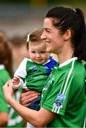 24 August 2019; Áine McGovern of Fermanagh with her daughter Cádhlá, 10 months, after the TG4 All-Ireland Ladies Football Junior Championship Semi-Final match between Fermanagh and London at St Tiernach's Park in Clones, Monaghan. Photo by Ray McManus/Sportsfile