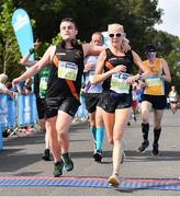 24 August 2019; Alan Monnelly and Laura Kernan of Clonliffe Harriers AC, Co. Dublin, celebrate after competing in the KBC & Dublin Marathon Race Series, where, over 5,200 runners took part in the Frank Duffy 10 Mile, part of the KBC Dublin Race Series 2019 at Phoenix Park in Dublin. Photo by Sam Barnes/Sportsfile