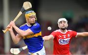 24 August 2019; Conor Bowe of Tipperary in action against Eoin Roche of Cork during the Bord Gáis Energy GAA Hurling All-Ireland U20 Championship Final match between Cork and Tipperary at LIT Gaelic Grounds in Limerick. Photo by Piaras Ó Mídheach/Sportsfile