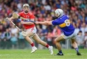 24 August 2019; Tommy O'Connell of Cork gets past Ciarán Connolly of Tipperary before scoring his side's first goal during the Bord Gáis Energy GAA Hurling All-Ireland U20 Championship Final match between Cork and Tipperary at LIT Gaelic Grounds in Limerick. Photo by Piaras Ó Mídheach/Sportsfile