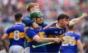 24 August 2019; Tipperary players, from left, Cathal Bourke, Ray McCormick and Conor Bowe celebrate following the Bord Gáis Energy GAA Hurling All-Ireland U20 Championship Final match between Cork and Tipperary at LIT Gaelic Grounds in Limerick. Photo by David Fitzgerald/Sportsfile
