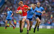 25 August 2019; Niamh Cotter of Cork in action against Carla Rowe of Dublin during the TG4 All-Ireland Ladies Senior Football Championship Semi-Final match between Dublin and Cork at Croke Park in Dublin. Photo by Brendan Moran/Sportsfile