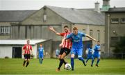 25 August 2019; Gareth Brady of Crumlin United in action against Marco Chinden of Lucan United during the Extra.ie FAI Cup Second Round match between Crumlin United and Lucan United at CBS Captain's Road in Crumlin, Dublin. Photo by David Fitzgerald/Sportsfile