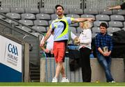 25 August 2019; Dublin footballer Michael Darragh MacAuley watches on during the Gaelic4Mothers and Others game with the Sheriff Street team during the TG4 All-Ireland Ladies Senior Football Championship Semi-Final match between Dublin and Cork at Croke Park in Dublin. Photo by Sam Barnes/Sportsfile