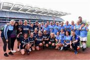 25 August 2019; Dublin footballer Michael Darragh MacAuley and the teams from the Gaelic4Mothers and Others game pose for a photograph during the TG4 All-Ireland Ladies Senior Football Championship Semi-Final match between Dublin and Cork at Croke Park in Dublin. Photo by Sam Barnes/Sportsfile