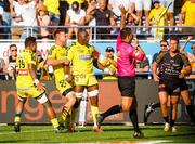 25 August 2019; Judicael Cancoriet of Clermont celebrates scoring a try with tean-mates, Faifili Levave, left, and Jacobus Van Tonder, centre, during the LNR Top 14 match between ASM Clermont Auvergne and La Rochelle at Stade Marcel-Michelin in Clermont-Ferrand, France. Photo by Romain Biard/Sportsfile