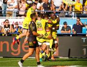 25 August 2019; Judicael Cancoriet of Clermont celebrates scoring a try with tean-mates during the LNR Top 14 match between ASM Clermont Auvergne and La Rochelle at Stade Marcel-Michelin in Clermont-Ferrand, France. Photo by Romain Biard/Sportsfile