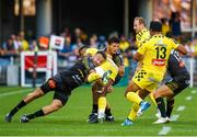 25 August 2019; Judicael Cancoriet of Clermont is tackled during the LNR Top 14 match between ASM Clermont Auvergne and La Rochelle at Stade Marcel-Michelin in Clermont-Ferrand, France. Photo by Romain Biard/Sportsfile