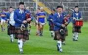 24 August 2019; Tipperary captain Craig Morgan leads his team-mates in the pre-match parade behind the St Patrick's Pipe Band, from Tulla, Co Clare, before the Bord Gáis Energy GAA Hurling All-Ireland U20 Championship Final match between Cork and Tipperary at LIT Gaelic Grounds in Limerick. Photo by Piaras Ó Mídheach/Sportsfile