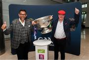 30 August 2019; Tony Links from Scotland, left, and Oliver Kelly from Roscommon with the Sam Maguire Cup at the GAA's Home for the Match stand in the arrivals hall at Dublin Airport. Photo by Matt Browne/Sportsfile