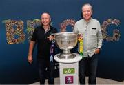 30 August 2019; John Conroy, left, and Enda Raftery from Tulsk, Co. Roscommon, back from Chicago to watch the All Ireland Final, with the Sam Maguire Cup at the GAA's Home for the Match stand in the arrivals hall at Dublin Airport. Photo by Matt Browne/Sportsfile