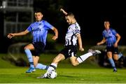 30 August 2019; Michael Duffy of Dundalk shoots to score his side's third goal despite the attention of Yoyo Mahdy of UCD during the SSE Airtricity League Premier Division match between UCD and Dundalk at The UCD Bowl in Belfield, Dublin. Photo by Ben McShane/Sportsfile