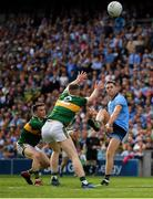 1 September 2019; Dean Rock of Dublin kicks a point under pressure from Paul Murphy and Jason Foley of Kerry during the GAA Football All-Ireland Senior Championship Final match between Dublin and Kerry at Croke Park in Dublin. Photo by Seb Daly/Sportsfile