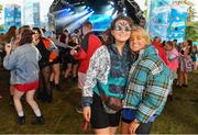 1 September 2019; Festival-goers Ella Ash, left, and Helena Rohan from Dingle, Co. Kerry, in attendance at the Electric Ireland Throwback Stage during day three of Electric Picnic 2019 at Stradbally in Laois. Smash Hits deliver a smashing performance at Electric Ireland's Throwback Stage. It's 90s time at Electric Ireland's Throwback Stage as Smash Hits bring a smooth mix of nostalgic numbers to Stradbally. Closing out a weekend of throwback fun at Electric Ireland's Throwback Stage – Smash Hits pave the way for the final headline act, N-Trance. This year, Electric Ireland's Throwback Stage hosts a line-up of legends including headliners Bonnie Tyler, N-Trance, Mr. Motivator and Lords of Strut. One of the most popular stages at the festival, Electric Ireland's Throwback Stage has previously played host to pop legends B*witched, Johnny Logan, Heather Small, 5ive, S Club Party, Ace of Base, 2 Unlimited, The Vengaboys and Bananarama – to name a few. Share in the nostalgia of the Electric Ireland Throwback Stage, visit: www.twitter.com/ElectricIreland, www.facebook.com/ElectricIreland, www.instagram.com/ElectricIreland.  #ThrowbackThrowdown. Photo by Sam Barnes/Sportsfile