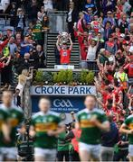 1 September 2019; Cork captain Conor Corbett lifts the Tom Markham Cup after the Electric Ireland GAA Football All-Ireland Minor Championship Final match between Cork and Galway, as Kerry make their way onto the pitch for the senior final against Dublin, at Croke Park in Dublin. Photo by Piaras Ó Mídheach/Sportsfile
