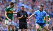 1 September 2019; Referee David Gough writes in his notebook after Tom O'Sullivan of Kerry fouled John Small of Dublin in the 51st minute as David Moran of Kerry and Brian Fenton of Dublin look on during the GAA Football All-Ireland Senior Championship Final match between Dublin and Kerry at Croke Park in Dublin. Photo by Piaras Ó Mídheach/Sportsfile