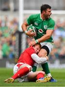 7 September 2019; Robbie Henshaw of Ireland is tackled by Rhys Patchell of Wales during the Guinness Summer Series match between Ireland and Wales at Aviva Stadium in Dublin. Photo by David Fitzgerald/Sportsfile