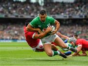 7 September 2019; Rob Kearney of Ireland scores his side's first try despite the tackle from Leigh Halfpenny of Wales during the Guinness Summer Series match between Ireland and Wales at Aviva Stadium in Dublin.Photo by Brendan Moran/Sportsfile