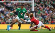 7 September 2019; Bundee Aki of Ireland is tackled by Rhys Patchell of Wales during the Guinness Summer Series match between Ireland and Wales at the Aviva Stadium in Dublin. Photo by Ramsey Cardy/Sportsfile