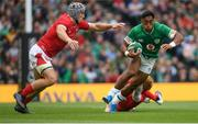 7 September 2019; Bundee Aki of Ireland in action against Jonathan Davies, left, and Rhys Patchell of Wales during the Guinness Summer Series match between Ireland and Wales at the Aviva Stadium in Dublin. Photo by Ramsey Cardy/Sportsfile
