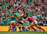7 September 2019; Robbie Henshaw of Ireland is tackled by Leigh Halfpenny of Wales during the Guinness Summer Series match between Ireland and Wales at Aviva Stadium in Dublin.Photo by Brendan Moran/Sportsfile