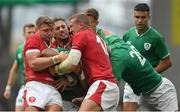 7 September 2019; Bundee Aki of Ireland, hidden, is tackled by Dan Biggar of Wales, left, and Josh Navidi, centre, and Hadleigh Parkes of Wales during the Guinness Summer Series match between Ireland and Wales at Aviva Stadium in Dublin. Photo by Ramsey Cardy/Sportsfile