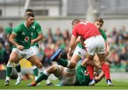 7 September 2019; George North of Wales is tackled by Garry Ringrose and Iain Henderson of Ireland, below, during the Guinness Summer Series match between Ireland and Wales at the Aviva Stadium in Dublin. Photo by Ramsey Cardy/Sportsfile