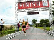 7 September 2019; Sinead O'Connor from Leevale Athletic Club Co Cork celebrates winning the Kia Race Series – Round 8 at Blessington Lakes in Wicklow. Photo by Matt Browne/Sportsfile