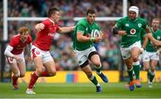 7 September 2019; Robbie Henshaw of Ireland in action against Josh Adams of Wales during the Guinness Summer Series match between Ireland and Wales at the Aviva Stadium in Dublin. Photo by Ramsey Cardy/Sportsfile