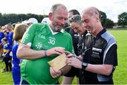 7 September 2019; Dementia advocate Kevin Quaid gives Kilkenny referee Seán Cleere a suspicious brown Envelope before The Alzheimer Society of Ireland hosting Bluebird Care sponsored Tipperary v Limerick hurling fundraiser match at Nenagh Éire Óg, Nenagh, Co Tipperary. This unique fundraising initiative, to mark World Alzheimer's Month 2019, was the brainchild of two leading Munster dementia advocates, Kevin Quaid and Kathy Ryan, who both have a dementia diagnosis. All the money raised will go towards providing community services and advocacy supports in the Munster area and beyond. Photo by Piaras Ó Mídheach/Sportsfile