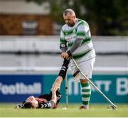 7 September 2019; Chris McElligott of Shamrock Rovers assists Neil Hoey of Bohemians during the Megazyme Amputee Football League Cup Finals at Carlisle Grounds in Bray, Co Wicklow. Photo by Stephen McCarthy/Sportsfile