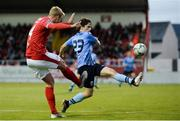 7 September 2019; Kris Twardek of Sligo Rovers takes a shot at goal under pressure from Evan Farrell of UCD during the Extra.ie FAI Cup Quarter-Final match between Sligo Rovers and UCD at The Showgrounds in Sligo. Photo by Oliver McVeigh/Sportsfile