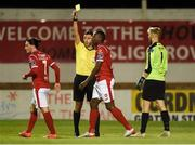 7 September 2019; Referee Paul McLaughlin issues a yellow card to Romeo Parkes of Sligo Rovers, centre, for simulation during the Extra.ie FAI Cup Quarter-Final match between Sligo Rovers and UCD at The Showgrounds in Sligo. Photo by Oliver McVeigh/Sportsfile